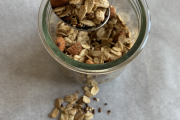 serving of vegan granola on spoon and in a glass