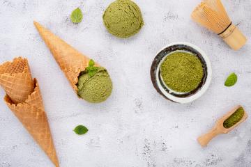 matcha powder and vegan matcha ice cream artistically styled flat-lay