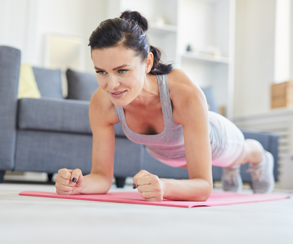 woman over 40 doing a plank in her home